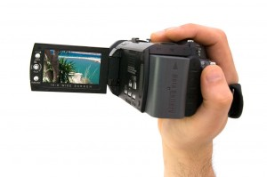 Hand holds video camera